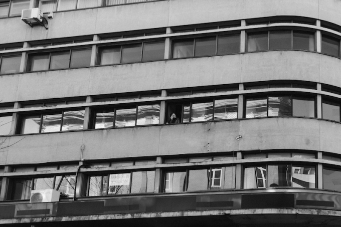 porto-woman-smoking-in-the-apartment-tower